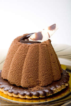 Chocolate mousse cake on top of a glazed cookie dessert isolated Zdjęcie Seryjne