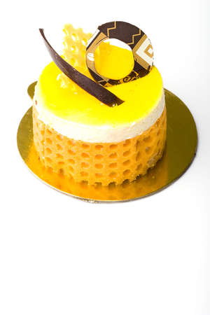 Delicious lemon fruit mousse cake pastry isolated
