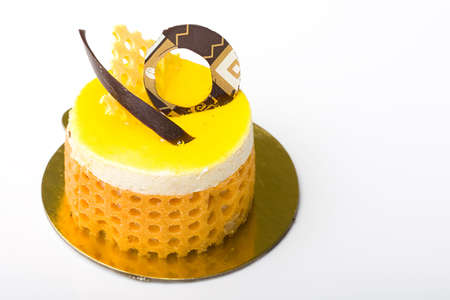 Delicious lemon fruit mousse cake pastry over white