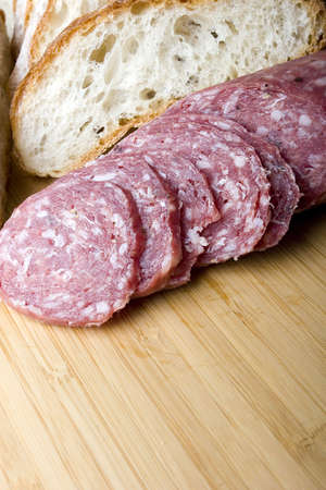 Italian salami sausage sliced with brick oven delicious fresh baked bread for sandwich