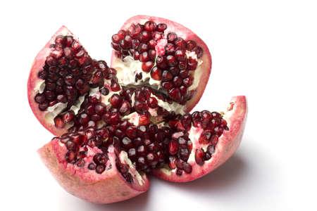 Fresh ripe pomegranate fruit cut open isolated