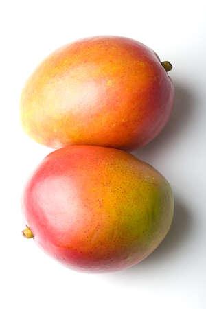 Pair of fresh ripe delicious mango tropica fruit over white background Zdjęcie Seryjne