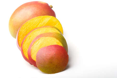 Fresh ripe delicious juicy mango tropical fruit sliced isolated