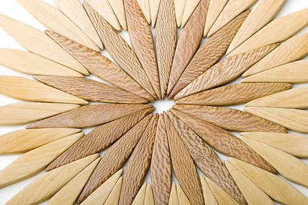 Natural wooden abstract background in a shape of sun and flower Zdjęcie Seryjne