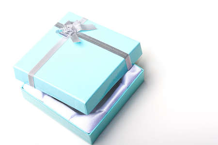 Beautiful elegant glossy blue empty jewelry gift box with silver ribbon with open top lid