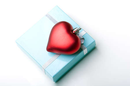 Elegant beautiful glossy blue jewelry gift box with ribbon and red valentine day heart present isolated