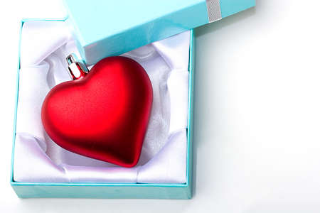 Red heart ornament decoration love symbol gift in a jewelry box for Valentine Day celebration present isolated