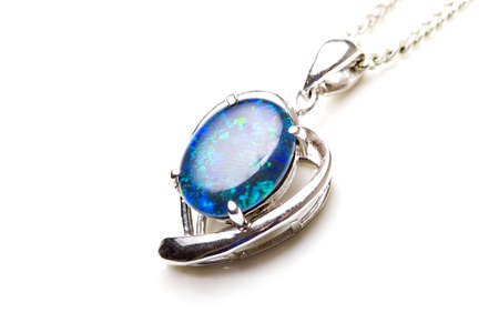 Elegant beautiful jewelry single opal stone pendant in sterling silver heart shape setting isolated