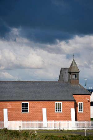 house of god: Scandinavian Church under a dark cloud