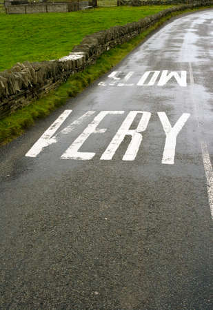 wetness: Irish road with driving instructions Stock Photo