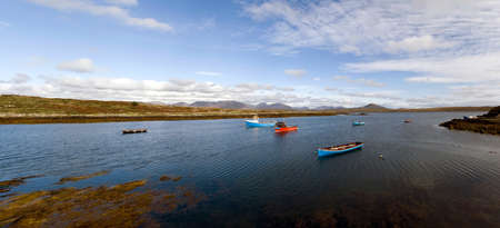 bens: Fishing boats in a natural harbor