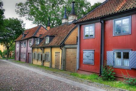 case colorate: Storiche case di legno a Stoccolma, Svezia Archivio Fotografico