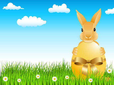 easter bunny with yellow egg on the green meadow