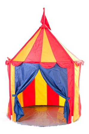 Open children circus tent with flag on top - striped, white background