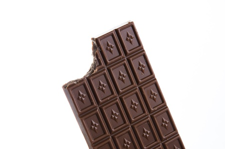 calorific: Bitten chocolate bar on white background Stock Photo