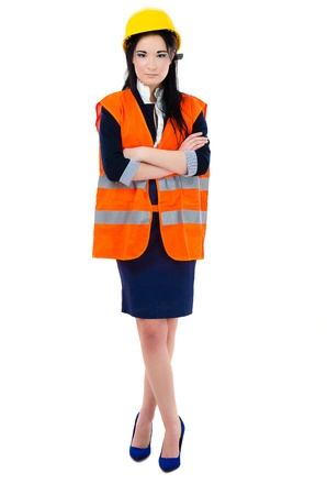 Architect  woman standing in high visibility vest photo