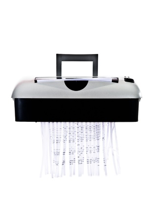 Office paper shredder at work - isolated on white background photo