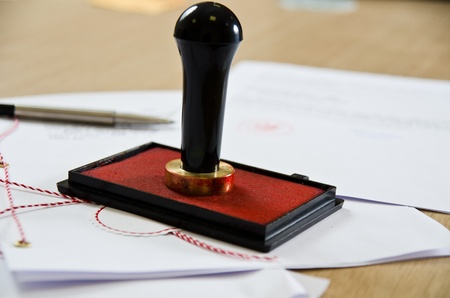 seal stamper: Stamp that is used by a notary public and signed document