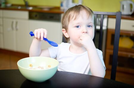 Little boy eating cereals Stock Photo - 12379367