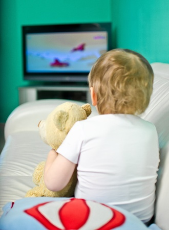 tv room: Baby boy watching cartoons