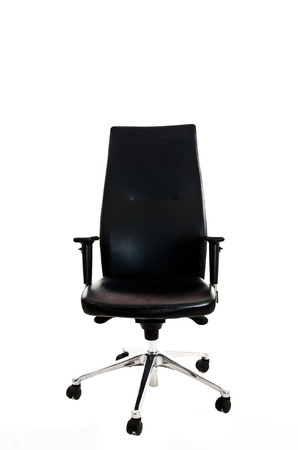 Black leather office armchair isolated on white background - front view photo