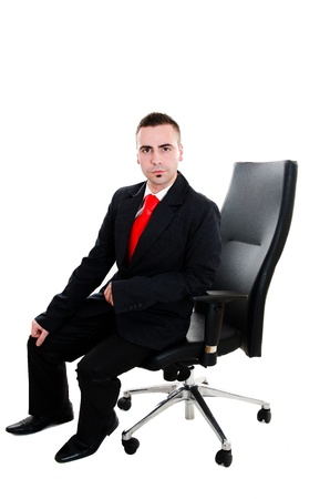 Young businessman sitting in office leather armchair - isolated on white Stock Photo - 12586352