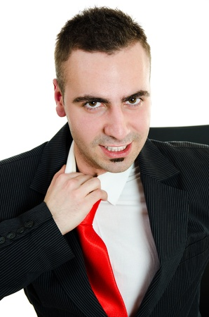 Angry young businessman yanking necktie in frustration Stock Photo - 12586367