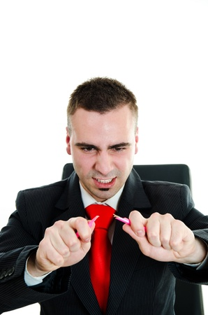 Furious angry businessman breaking a pencil photo