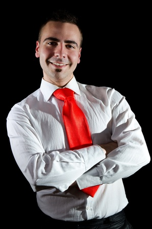 Portrait of smiling young businessman wearing red necktie Stock Photo - 12782536