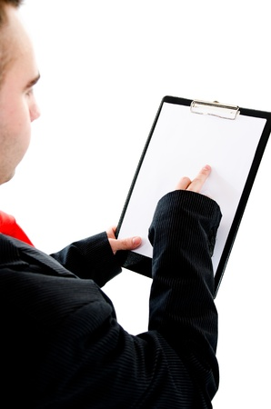 Young busiessman holding out a blank clipboard with space for text  Pointing on something with his finger Stock Photo - 12782548