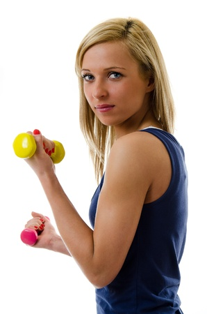 Pretty blonde girl training with dumb-bells photo