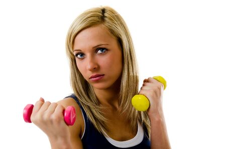 Blonde pretty fitness girl working out with dumbbells Stock Photo - 12782545
