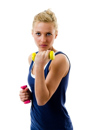 Blonde girl using dumbbells to train her biceps Stock Photo - 12782543