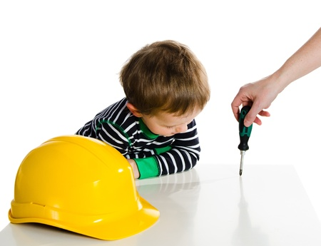 Boy playing with mechanic tools photo