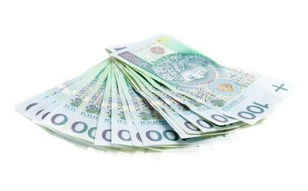 Polnische Geld isoliert auf weißem Hintergrund - viele 100PLN Banknoten. Standard-Bild