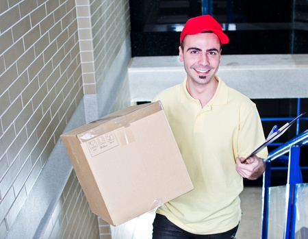 Courier during delivering packages Stock Photo - 13215739