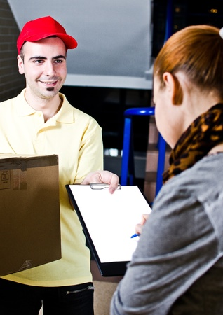 A handsome young courier delivering a package Stock Photo - 13215748