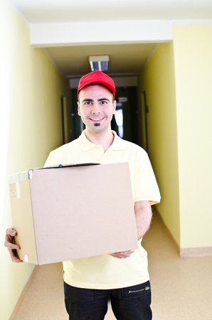 Your handsome delivery man during his work Stock Photo - 13215736