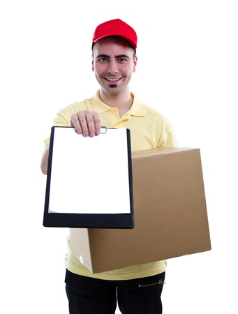 Delivery man in yellow polo and baseball hat with a parcel and a tablet isolated on white photo