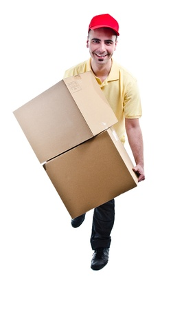 Smiling delivery man running with boxes - front view - isolated on white photo