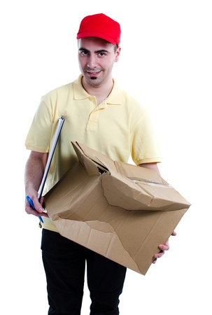 ship package: Delivery man scared for having damaged the parcel that distributes isolated over white background Stock Photo