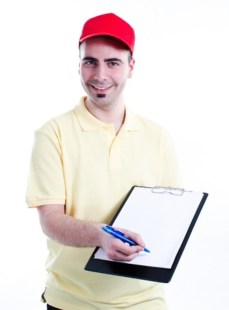 Young handsome delivery man with blank clipboard waiting for sign to delivery confirmation photo