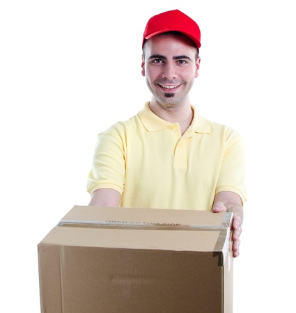 Young delivery man in yellow-red uniform holding the box on white background photo