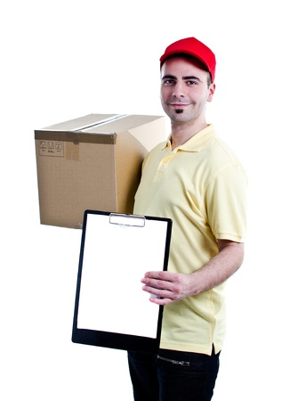 A smiling delivery man bringing a package and holding out a clipboard - isolated on white background   photo