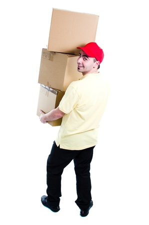 Young courier carrying three boxes - isolated on white - rear view Stock Photo - 13215685