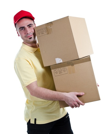 Young delivery man delivering two heavy parcels photo