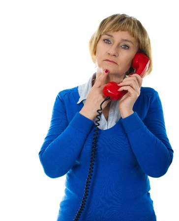 Mature 50 years old blonde woman during phone call - isolated on white background