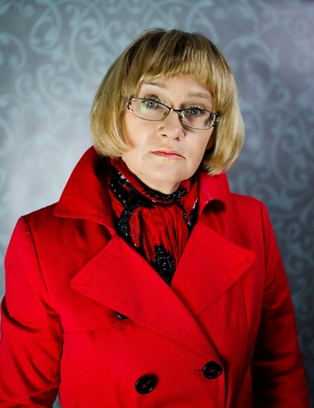 Mature blond woman in red coat  photo