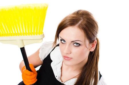 Young sexy housekeeping woman with broom - isolated on white background - elevated view photo