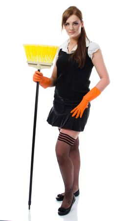 sweep: Woman in sexy stockings standing with yellow broom - isolated on white background Stock Photo